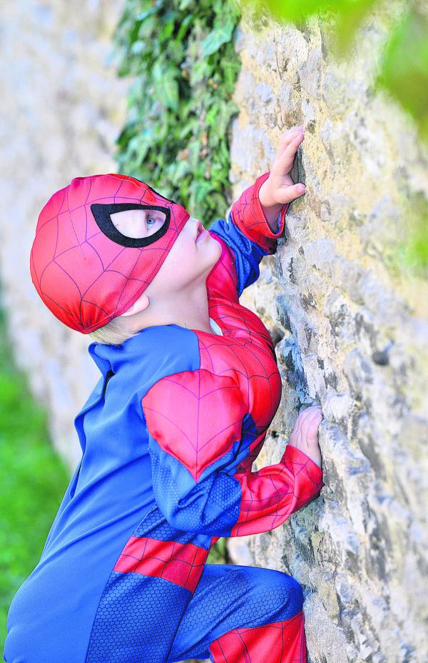 Leo Barker, four, joins in the fun at the superheroes party