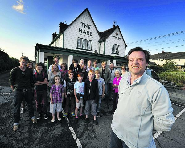 Piers Denne, right, and other residents are trying to raise £425,000 to buy The Hare and open it as a community-run pub