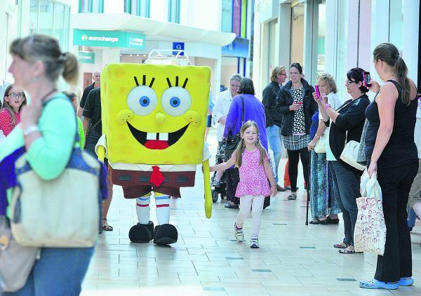 SpongeBob SquarePants holding hands with four-year-old Lucy Woodward