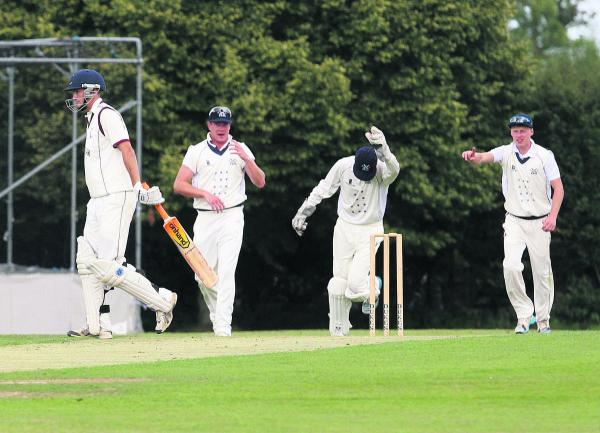 Aston Rowant wicket-keeper Dan Matthews leads the celebrations after taking the catch to dismiss Banbury opener Lloyd Sabin, who starts the long walk b
