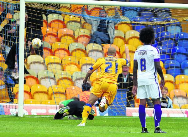 Former Oxford United skipper Adam Murray sinks his old side with the winner for Mansfield