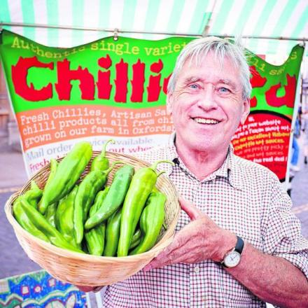 Ian Paxton, who farms chillis in Church Hanborough, holding a bowl of Anaheim chilli