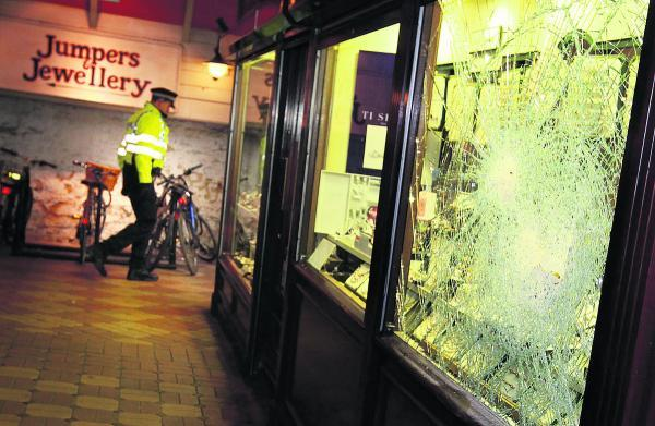 The window of John Gowing Jewellers following the raid