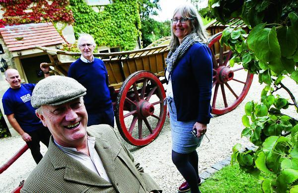 Front, David Willcock, who is playing villager John Sharp who used to drive the wagon, with village archivist Ian Costar and Christine Jeuckens, from Oxfordshire County Council  				                   Picture: OX69212 Ed Nix
