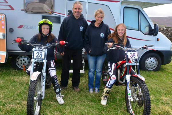 Alicia (left) and Leah Robinson line up with   parents Stuart a
