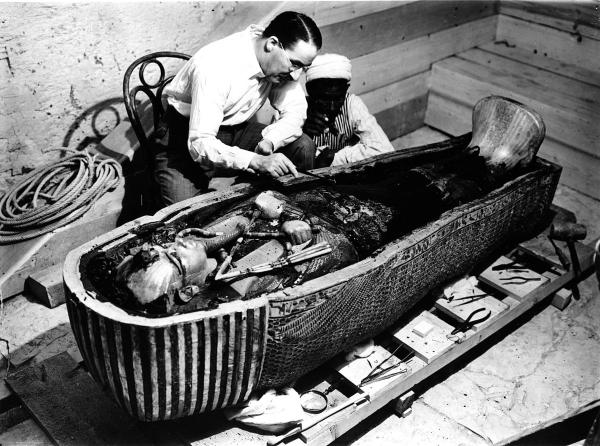 MASK REVEALED: Howard Carter and an unnamed assistant inspect Tutankhamun's innermost coffin