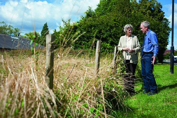 Respect: Anne Mogridge, parish council chairwoman, and David Henwood, vice-chairman, on the site of the proposed development in Littlemore