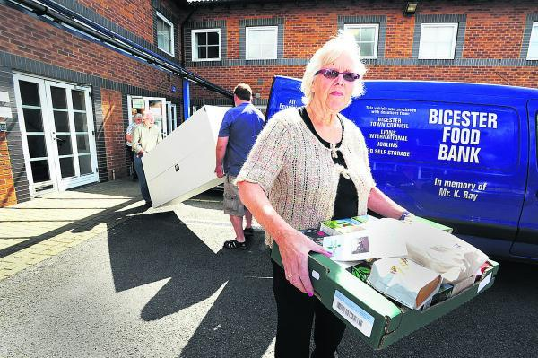 Manager Janet Ray removes stock from the foodbank's former base at Minton Place, Bicester