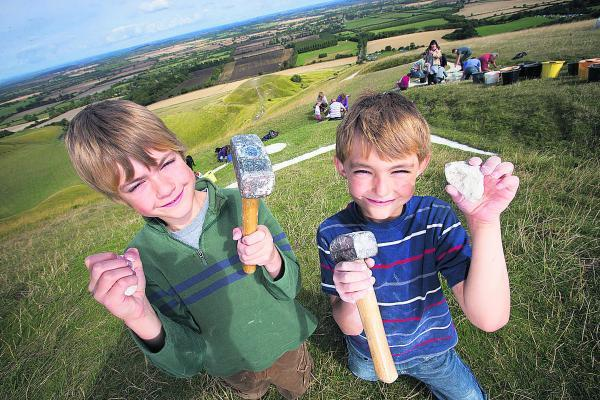 Nine-year-old Thomas Streatfield, left, who helped maintain the White Horse with his brother, Sam, seven. Picture: OX69410  Damian Halliwell