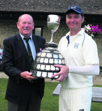 Marsh Gibbon's skipper Stuart Leonard receives the Telegraph Cup from Chippingh Norton president John Esson after their 33-run victory against Wantage