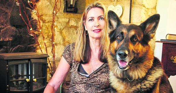 Valerie Blumenthal with Mozart, her German Shepherd, at her home in Moreton, near Thame