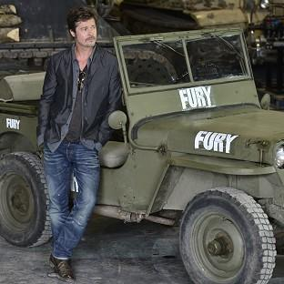 Brad Pitt during a photocall at the Tank Museum in Bovington, Do