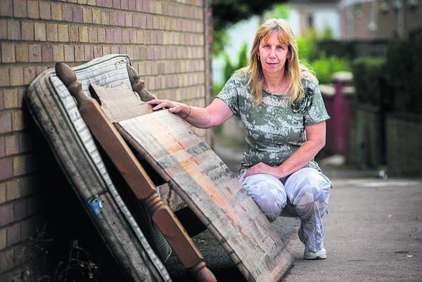 tidy up: Barton resident Linda Hill with dumped rubbish
