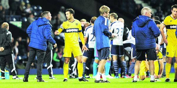 Michael Appleton (far left) talks with Jake Wright ahead of their penalty shoot-out defeat at West Brom on Tuesday night  Picture: Damian Halliwell Order no: OX69443