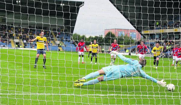 Danny Hylton beats Dagenham & Redbridge keeper Liam O'Brien to put Oxford 3-2 ahead on Saturday, but the  visitors hit back for a point to leave the U's still searching for a first league win of the season