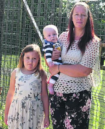 Lesley Senter at the fenced-off play area with daughter Evangeline, seven, and four-month-old grandson Logan Taylor