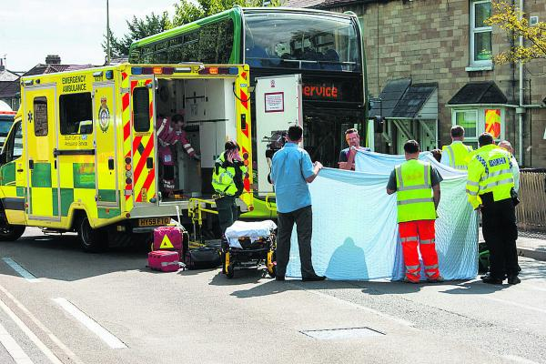 Police and ambulance crews at the scene of the accident at the Lake Street junction in Abingdon Road, Oxford