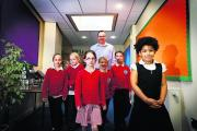 Cutteslowe Primary School headteacher Jon Gray with Year Four pupils strolling down one of their new corridors – from left, Mia Brain, William Rowe, Megan Holloway, Esther Reid, Louis Edmunds, Sacha Ignatjevs and Jasmin Smith