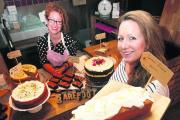 Baker Emily Jones, right, with shop manager Lucy Hoult, left, has opened a temporary outlet in the Covered Market. Picture: OX70113 Lucy Ford