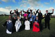 Pupils and event organisers with the rugby shirts they designed. Teacher Sean Masterson is crouched in the centre	     Picture: OX70685 Jon Lewis