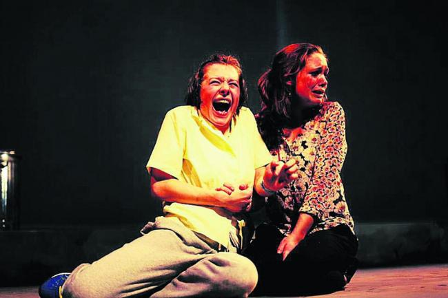 Contrasting emotions: Emma D'Arcy as Michal and Claire Bowman as Katurian Katurian