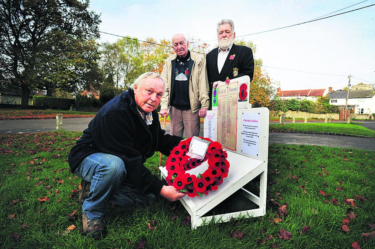 Keith Brooks, front, with two of Horspath's three surviving veterans of the Second World War, John Sheppard, left, and John West, with his memorial                                                             Picture: OX70917 Jon Lewis