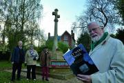 By Wheatley war memorial is co-editor Bill Jackson with the book They Were a Wall: Wheatley in A World at War 1914-19, with others who contributed, from left, John Fox, Anne Ledwith and John Prest      Picture: OX71060 Simon Williams