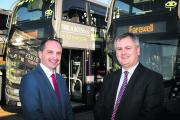 handover: Oxford Bus Company retiring managing director Philip Kirk, right, with his successor Phil Southall