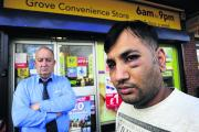 Shopkeeper Harish Modhvadiya, 31, right, was attacked by a gang of teenagers he was trying to throw out of his shop in Grovelands Shopping Centre. He is pictured with betting shop manager Bryan Ritchie
