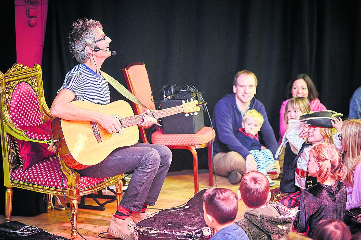 Nick Cope sings some of his songs to children at the Story Museum