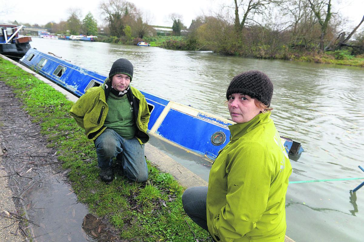 Jon Ody and Sam Dent of Green Boat Services, pictured with a narrow boat which sank near Iffley, are hoping to take over a dry dock near Osney Lock, which has been put on the market by the Environment Agency	Main picture: OX71352 Deni