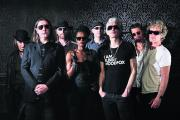 O2-bound: Alabama 3, with the Very Reverend second from left