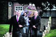 Pallbearers with the flower-strewn wicker coffin at the funeral of Koreen Davis in Harwell yesterday afternoon