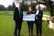 Alan Wood (left) and Fay Luteijn (right) hand over the cheque to Jane Elliott from See Saw