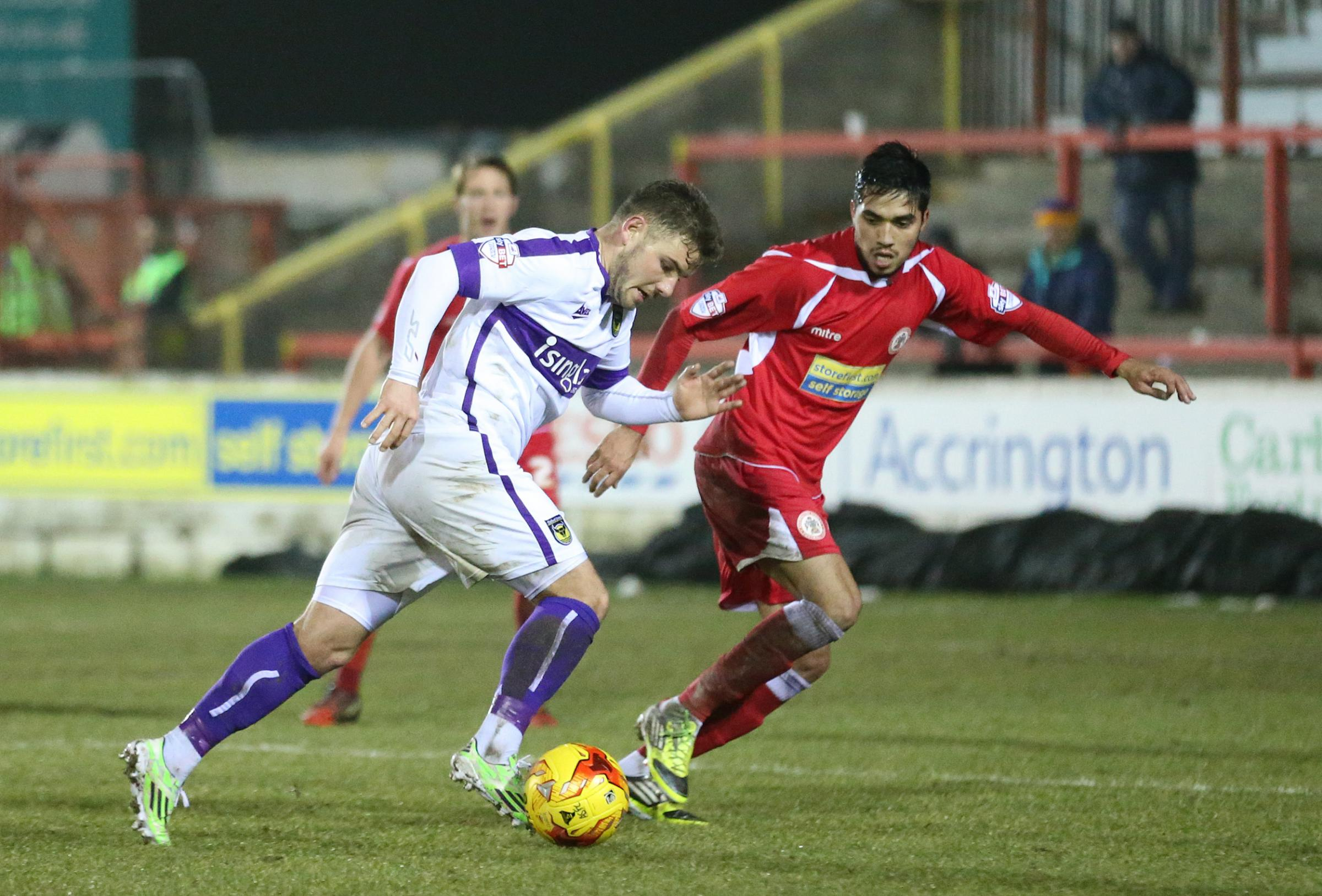 Alex MacDonald tries to force a way through the Accrington defence, but all in vain