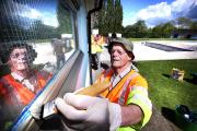 Revamp: Peter Harbour of the Friends of Abbey Meadows Outdoor Pool paints a window frame