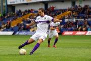 Danny Hylton scores a penalty at Mansfield in August