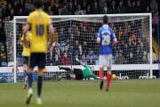 Oxford United goalkeeper Ryan Clarke gets down well to deny Portsmouth during Saturday's 0-0 draw at Fratton Park