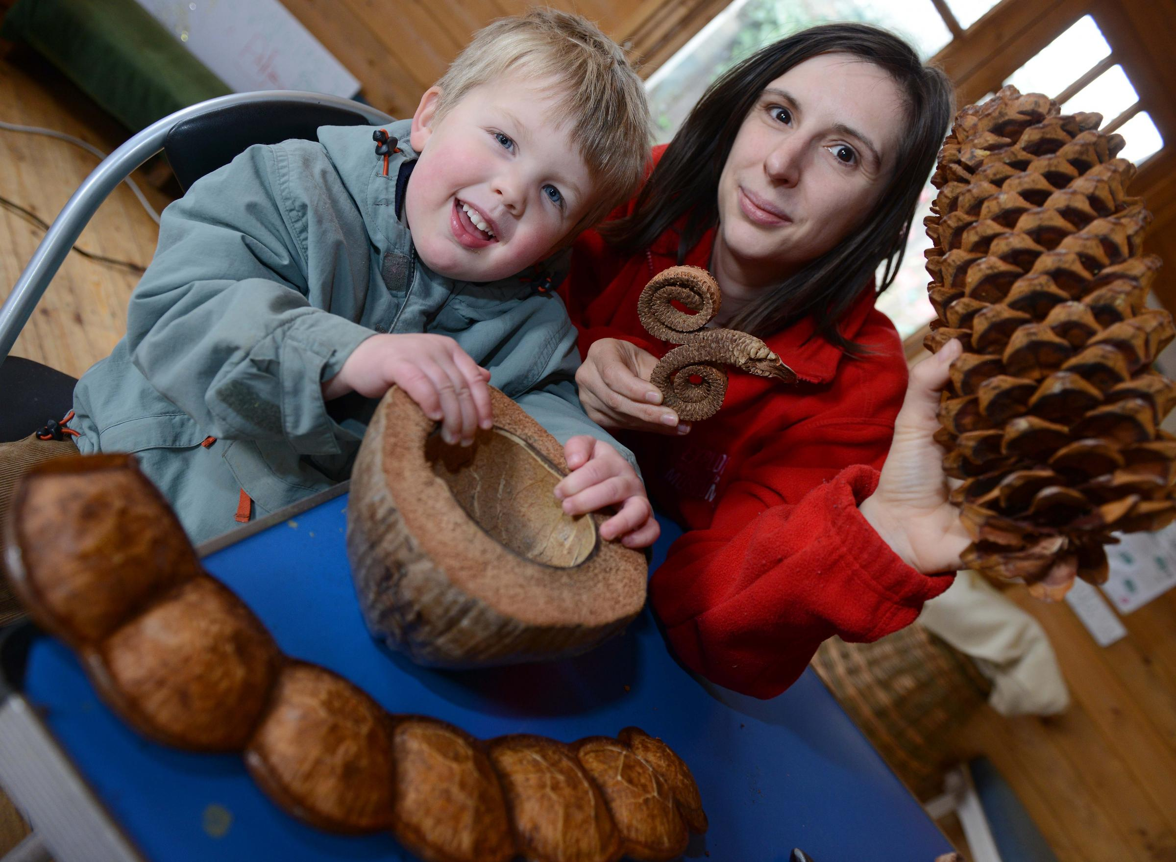 Three-year-old Rowan Davis-James and Susan Griffiths with some of the items. Picture: Simon Williams