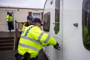 Police raid a caravan at Redbridge yesterday