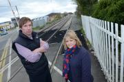 Concerns: Richard Mallows and Sallie Wright at the London Road level crossing in Bicester