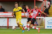 Liam Sercombe in action for Exeter City against Oxford this season. The midfielder has agreed a two-year deal with the U's