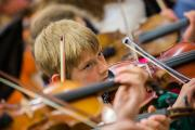 Brandon Hawkes, 10, from Long Furlong School, Abingdon, plays violin with children from around the county at a special Baroque rock string day. Picture: Damian Halliwell