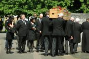 Final farewell: MP Andrew Smith watches a coffin carrying his wife Val being taken into the Church of the Holy Family in Blackbird Leys