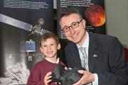 Delighted: Harwell scientist Martin Whalley with his son James at the Philae landing event last November