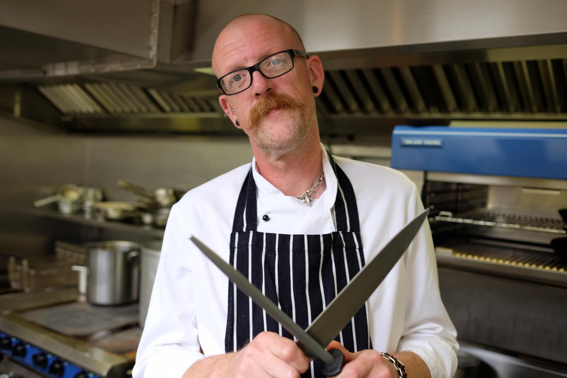 Chef Matt Read sharpens one of his kitchen knives