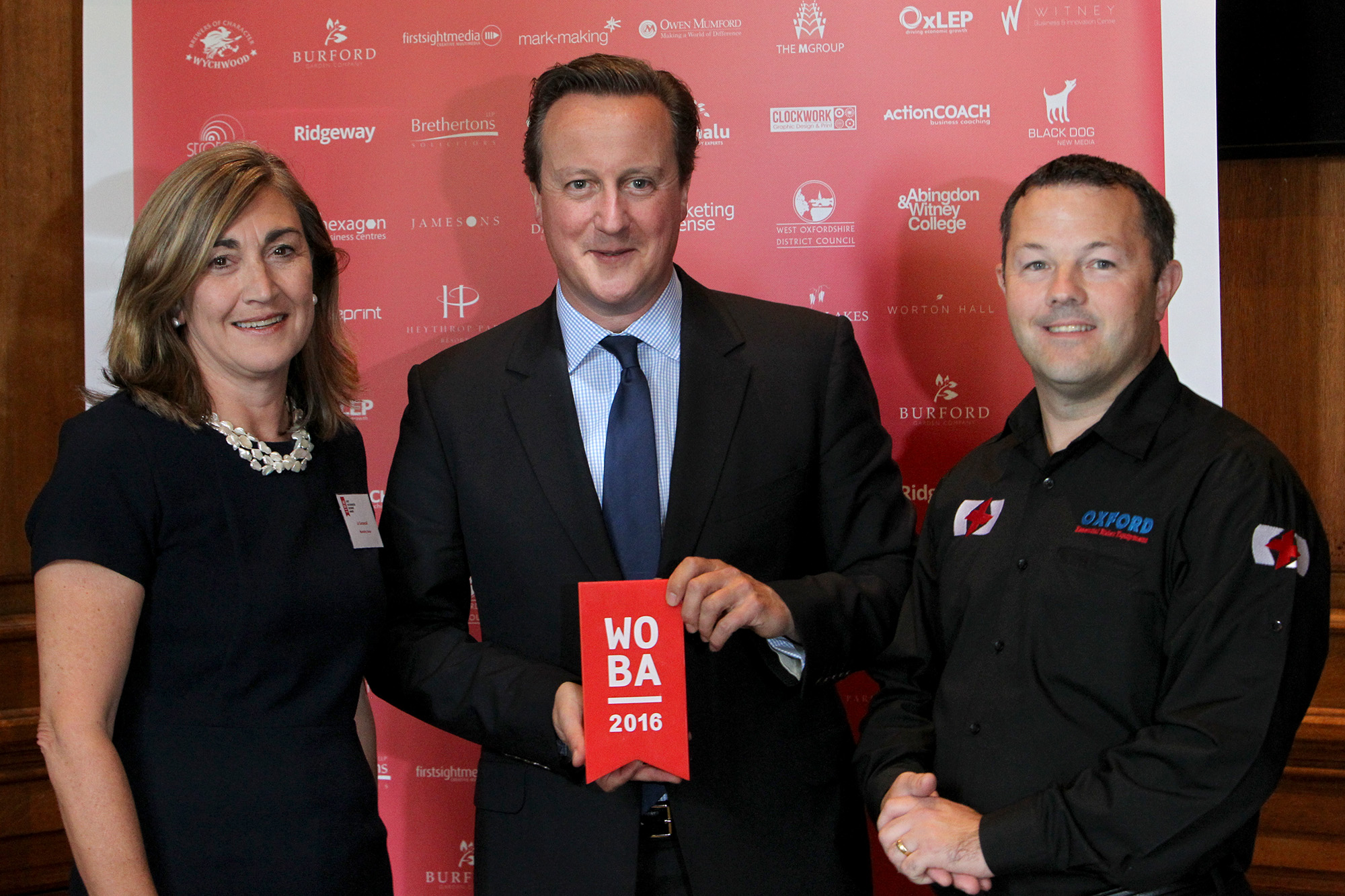 David Cameron with Jo Sensecall, of the West Oxfordshire Business Awards, and Andrew Hammond, winner of the 2015 West Oxfordshire Business of the Year award
