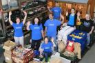 Volunteers: The Oxford Food Bank has provided more than 60 charities with supplies in the past year and gives away about ten tons of food a week
