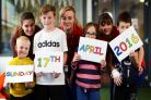 Big date: Thomas Hawkins, five, play specialist Katie Roberts, George Stanley, 11, play specialist Klarissa Burrows, Evie Hallas, seven, play specialist Alice Bird and Kai Gary, seven, announce next year's OX5 Run