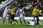 Blackburn Rovers clear the danger from a rare Oxford United attack in Saturday's Emirates FA Cup defeat at the Kassam Stadium